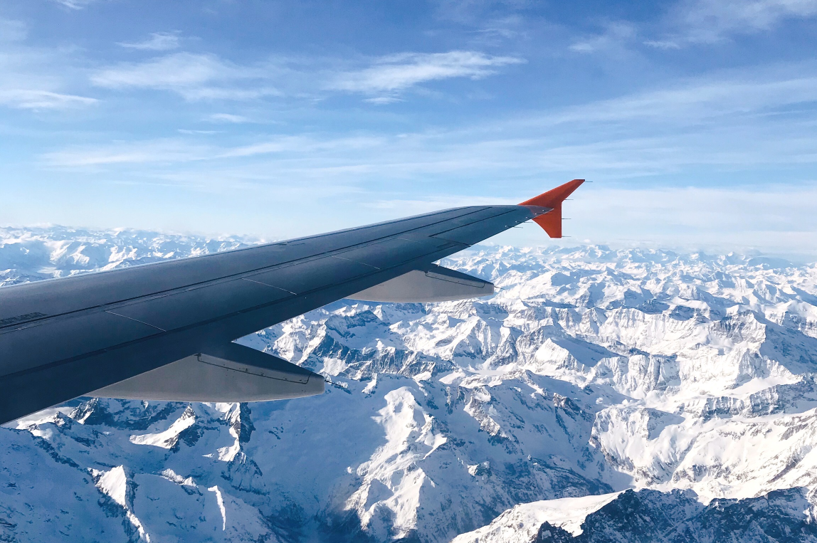 view from plane window over alps
